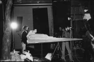 "Director George Lucas next to the iconic ""Star Destroyer"" from ""Star Wars"""