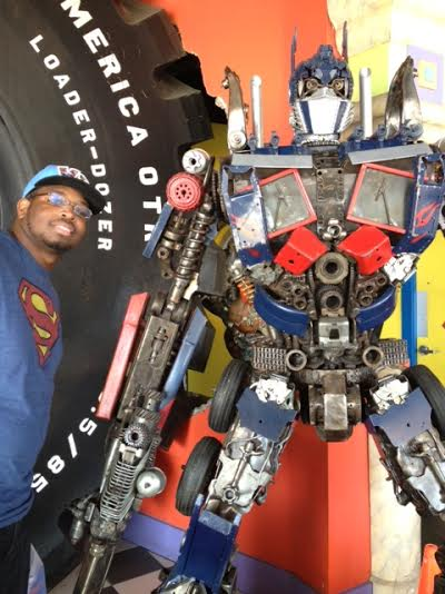 Eric Jones with a Transformer. Digging that Superman Tee!