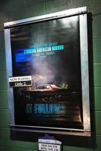 "The Official Poster for ""It Follows"" in the Lobby of ""The Little Theatre"" in Rochester, New York."